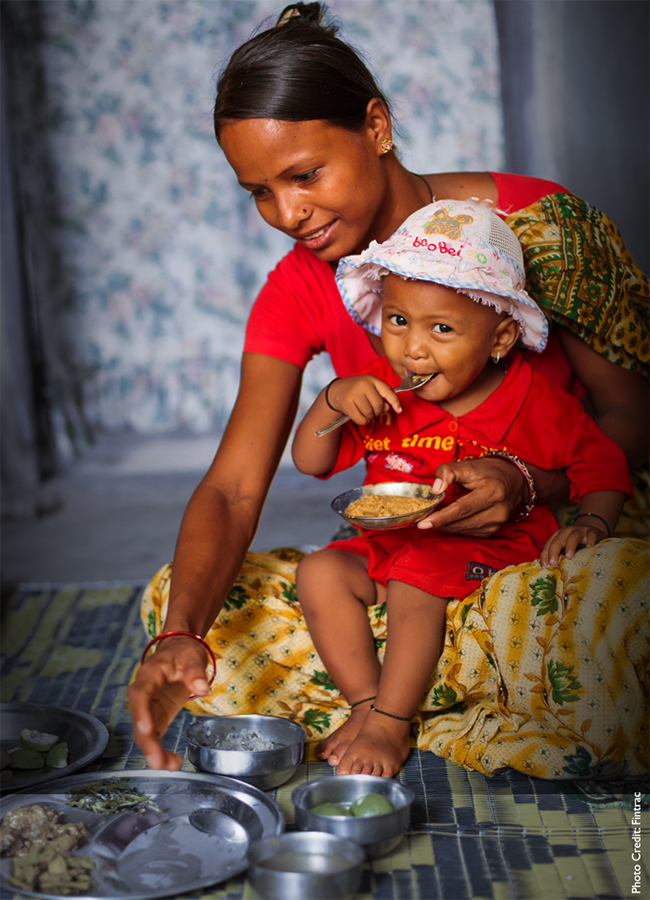 Woman and baby eating a meal.