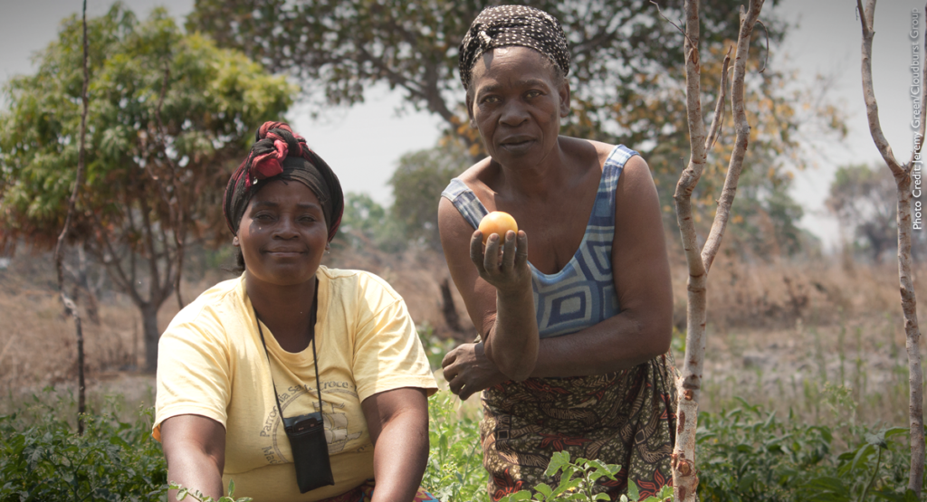 Two women in Zambia display the products of climate-smart agriculture