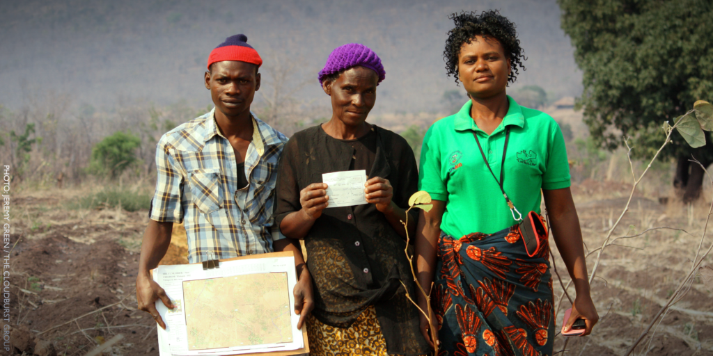 Three community members who mapped and recorded boundaries to certify customary land rights.
