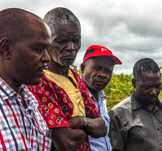 Men on a field visit in Zambia.