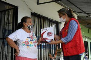 mayor giving woman land title