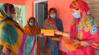 4 Indian women with envelopes
